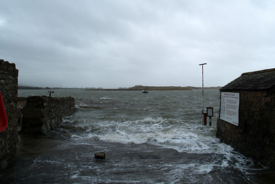 Road to the sea - viewed from over the top of the heavy storm gate protecting the cul-de-sac that is Ravenglass Main Street, high tide covers the River Esk estuary at Ravenglass, 08/03/08.