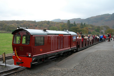 Douglas Ferreira at Dalegarth with two surprisingly full open coaches as part of the train consist, 04/11/06.