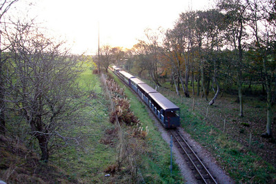 Douglas Ferreira leads the final down train of the day onto Barrow Marsh, seen here from the A595 road bridge at Muncaster Mill, 03/11/07.