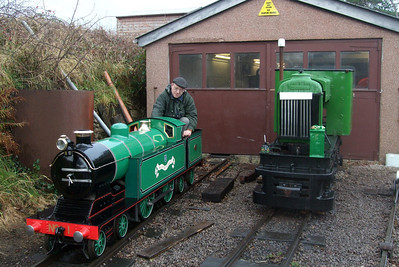 Dr Bob Tebb poses aboard his loco, Blacolvesley, with Quarryman alongside, 08/11/08.