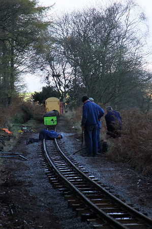 Sighting the level of the track prior to shovel-packing the ballast at Coronation Street, 11/11/09.