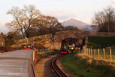 Douglas Ferreira crosses with River Irt at Irton Road, with Harter Fell on the skyline. 13/11/11.