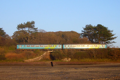 A Class 156 unit in the old Northern Spirit livery passes Walls Bridge south of Ravenglass, 06/10/07.