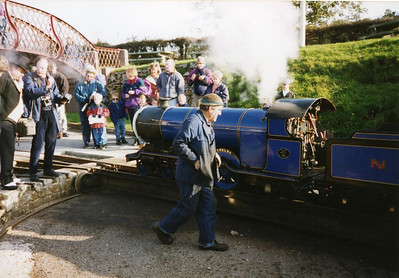 "Synolda, ""La'al Edward"", on the turntable at Ravenglass, The Fat Controller keeping a close eye from nearby."