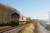 66142 runs along Hessle Foreshore at 11:09 on Thursday 29th December 2016 with the 09:52 Hull Coal Terminal - Gascoigne Wood. The train is formed of open MBA's loaded with imported Gypsum - also of note are the new pattern light clusters on the loco.