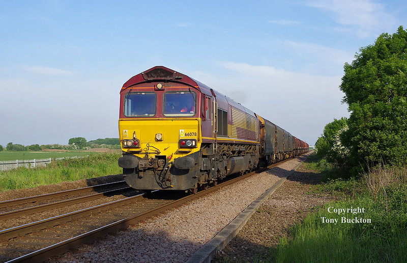 66078 passes Lowfield Lane, Melton, at 07:11 on Tuesday 22nd May 2018 with the 05:40 Masborough - Hedon Road Sidings steel hoods.