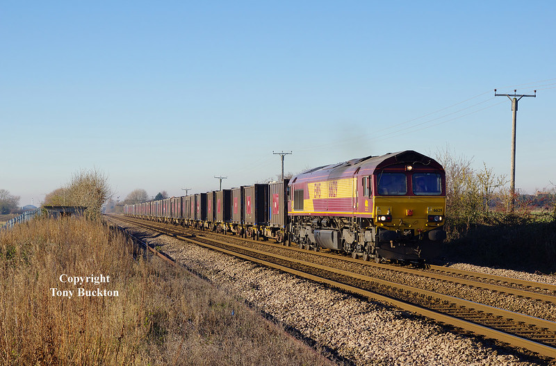 66129 heads the 11:52 Milford West Sidings - Hull Coal Terminal gypsum containers past Lowfield Lane, Melton, at 12:47 on Tuesday 29th November 2016.