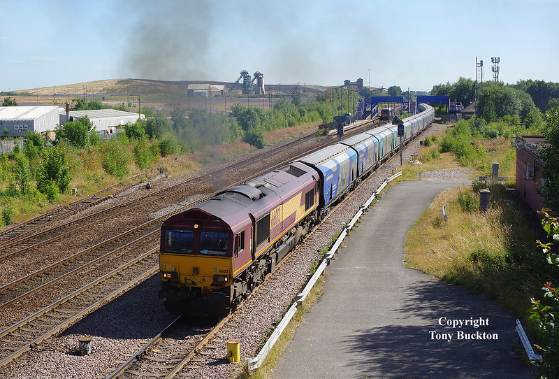 66012 passes Hatfield and Stainforth at 09:55 on the morning of 2nd July 2018 with the 08:15 Immingham - Drax Power Station Biomass hoppers.