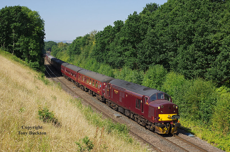 37706 approaches Normantan at Goose Hill with Thursday 5th July 2018's 'The Scarborough Spa Express', running as 1Z25 05:55 Southport - Scarborough, 37669 is attached at the rear.