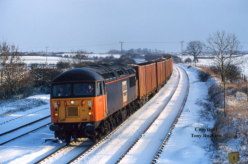 56102 passes New Barnetby  with the 6D85 08:52 Grimsby - Roxby Gullett Tioxide containers at 10:40 on December 31st 1996.