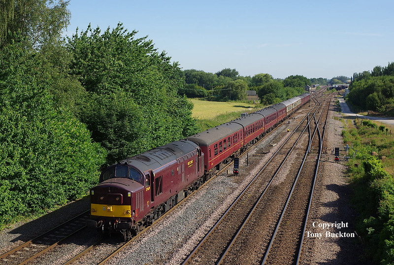 37669 heads West Coast Railways 'Dalesman' (1Z45 08:34 York - Carlisle) through Milford Junction at 08:49 on Monday 2nd July 2018.