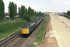 45136 approaches Hessle just a few mins into its journey on Tuesday May 28th 1985 with the 1J01 13:24 Hull - Sheffield portion for 1O86 14:00 Leeds - Brighton .  The working would pause at Sheffield for the attachment of a portion from Leeds before continuing - hence the uncharacteristic short rake of air-conditioned MkII's which look rather strange behind a Peak!