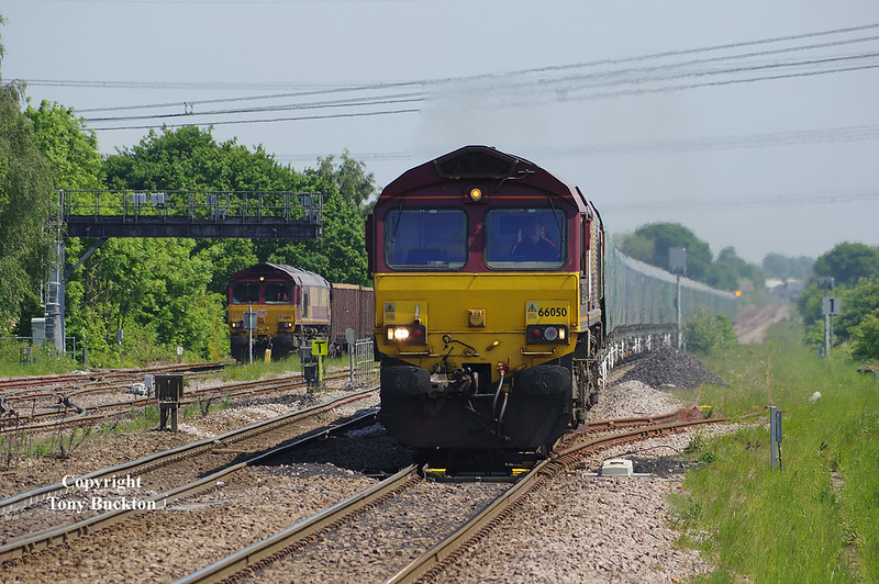 66050 passes 66174 stood in the sidings at Sudforth lane at 13:49 on Thursday 24th May 2018 whilst hauling the 13:33 Drax Power Station - Hull Biomass LP empty hoppers. 66174 awaits departure with the 14:15 Kellingley Colliery - Killingholme.