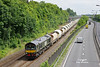 66779 passes Hessle on Wednesday 14th June 2017 with the 6D72 11:32 Hull Dairycoates - Rylstone empty Tarmac hoppers. A recent variation of hopper types on this working has done much to add interest to the otherwise uniform rake.