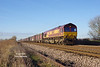 66069 passes Lowfield Lane, Melton, at 12:44 on Thursday 5th January 2017 with the 11:52 Milford West Sidings - Hull Coal Terminal empty gypsum containers.