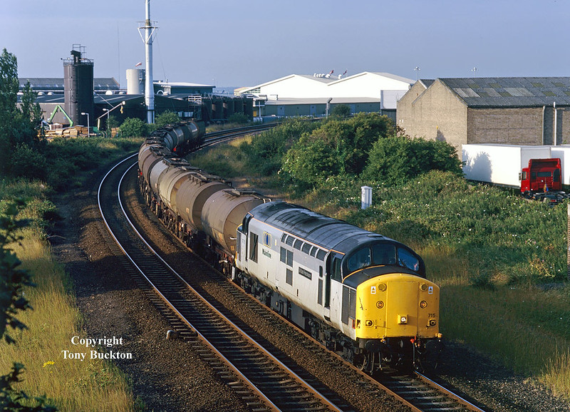 37715 approaches Hessle Road Junction, where the branch will be taken to Hull Docks, at 06:45 on the morning of the July 16th 1998 with the previous evenings 6E33 Baglan Bay - Saltend Acitic Acid tanks.