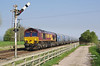 66131 passes Crabley Creek at 15:18 on the glorious afternoon of Saturday 8th April 2017 with the 14:28 Hull Biomamass LP - Drax Power Station.