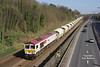 Running an hour later than normal due to a cable theft earlier in the morning, 66721 catches the sunlight at a perfect angle as it passes through Hessle with the 6D72 12:32 Hull Dairycoates - Rylstone empty Tarmac hoppers on Wednesday 15th March 2017.<br /> This  location sees a rather short window of opportunity for photography before the clocks go to British Summer Time due to shadows being cast throughout the winter months by  some rather tall trees just out of shot to the right.