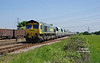 66606 passes Sudfort Lane sidings at 13:42 on Thursday 24th May 2018 with the 13:24 Drax AES - Tunstead empty limestone hoppers.