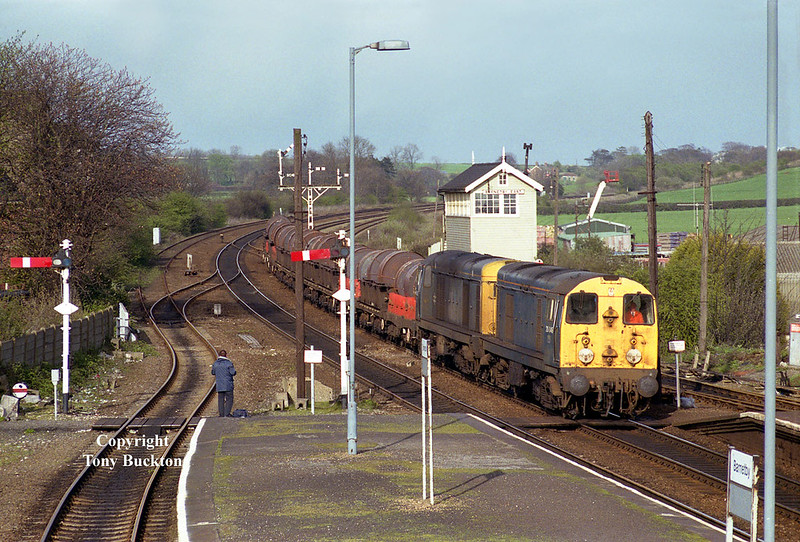 20046 and 20185 pass  Barnetby East signal box in the glorious evening sunlight of April 15th 1992 with an unidentified working of steel coils from Grimsby.