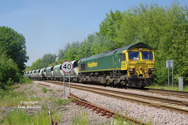 66606 is about to cross Joan Croft Lane LC at 14:39 on Thursday 24th May 2018 with the 13:24 Drax AES - Tunstead empty limestone hoppers.