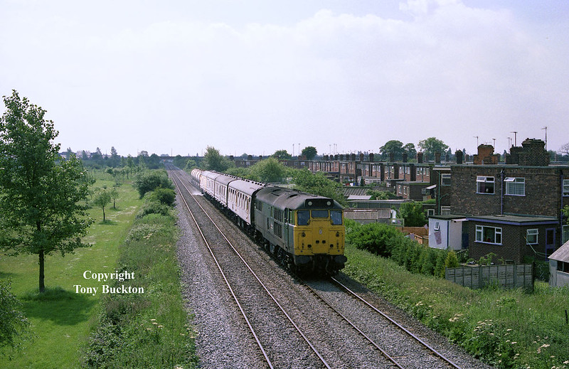 31234 powers the Eastern Region Weedkilling train as it passes Hotham Road (Hull) footbridge at approximately 11:45 on June 26th 1985 with the return working from Hull - Scarborough. The exact details of the working are unknown, but probably originated from York before running to Scarborough to cover the line to Hull.