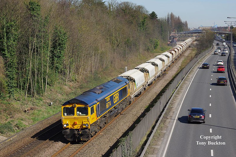Running just under an hour late, 66714 makes for a fine sight passing through Hessle on Saturday 25th March 2017 with the 6D72 11:57 Hull Dairycoates - Rylstone empty Tarmac hoppers.<br /> The combination of late running and the Greenwitch Mean Time clock setting provided what should be a last chance to photograph the working with the sun on the front at this location, at least until British Summer Time is dispensed with for a further six months in the Autumn.