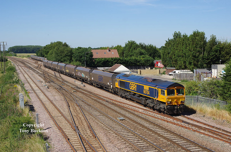 66704 passes Stainforth with the 4R79 10:09 Doncaster Down Decoy - Immingham HIT empty hoppers at 10:44 on Monday 2nd July 2018.