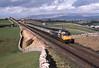 "47488 ""Rail Riders' crosses Birkett Commonon a Carlisle - Leeds Service.<br /> 11/03/1989"