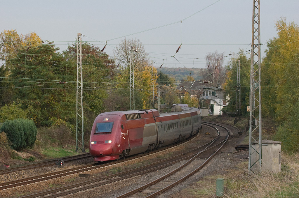 <b>22-Oct-2008</b>  Another shot from the same location, but with some elevation gained by putting the sound barrier to good use. The Thalys high speed train is a variant of the French TGV, running between Cologne and Paris-Nord by way of Brussels.  <i>Westbound Thalys in Eschweiler.</i>