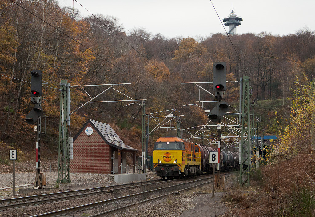 <b>25-Nov-2011</b>  There's no complaining after such a beautiful month but it looks like we're back to our normal Belgian winter weather. It was fun while it lasted.  Speaking of lasting fun, Railfeeding 1101 was back for more today and hauled a biodiesel tank car train westbound out of Aachen. Here she's seen seconds after exiting the Trois Bornes tunnel. That's Tour Baudouin on top and as you can see German catenary and German signals.  The substantial building houses electrical equipment for the overhead - no sissy prefab metal sheds here, we've got bricks! The Infrabel logo adds a nice touch. It's hard to believe it's been three years since all those wires went up...  <i>Railfeeding 1101 with biodiesel tank car train Ingolstadt/D - Gent in Gemmenich.</i>
