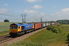 In another historic livery, Metronet  66719 climbs Belstead bank in the summer sun on 4M23 Felixstowe - Hams Hall GB Liner