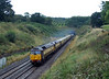 47790 + 47832 on 1Z21 Birmingham International ~ Paignton storm out of Whiteball Tunnel on 26-08-11