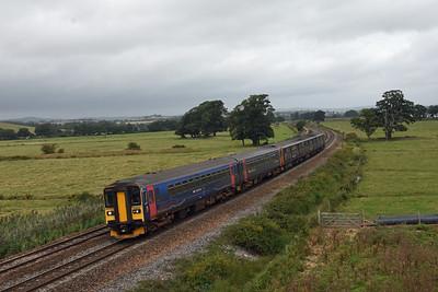 2C45 0928 Exeter to Penzance 153318 153369 150938 (57219 + 150238). Powderham 0936