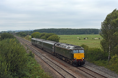 57604 working 2C51 1751 Exeter St Davids - Penzance passes the site of the old Exminster station 1757 in typical summer gloom