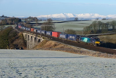 "88002 ""Prometheus"" passes Docker with the Tesco train on 23/1/19"