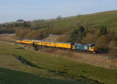 """37025 """"Inverness TMD"""" brings up the rear of a Blackpool-Derby measurement train at Giggleswick 24/3/17."""