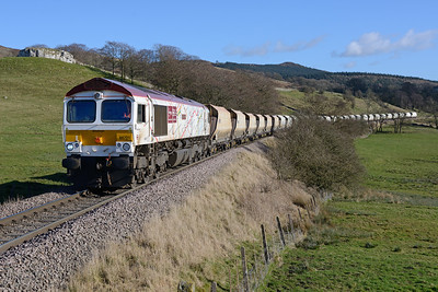 """66721 """"Harry Beck"""" hauls empties from Hull to Rylstone near Flasby 9/3/17."""