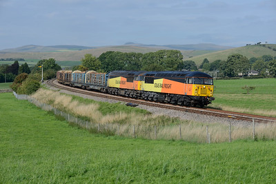 56090 + 56113 haul the Carlisle-Chirk logs away from Hellifield on 1/9/18.