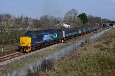 """A fleeting visit from 37419 """"Carl Haviland"""" to the Cumbrian Coast, seen departing Millom on the 11.40 Barrow-Carlisle 23/3/17."""