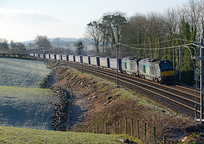 68002+68019 head north near Oxenholme with the Tesco train 21/1/17.