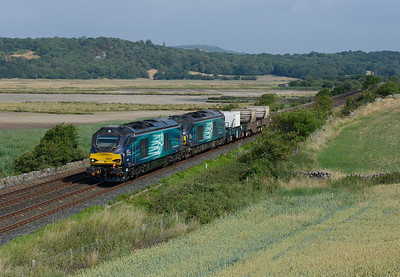 """68001 """"Evolution"""" + 68016 """"Fearless"""" approach Carnforth with Sellafield-Crewe flasks on 14/7/18."""