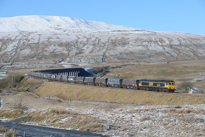 "66742 ""ABP Port of Immingham Centenary 1912-2012"" passes Ribblehead with an Arcow-Pendleton stone train, 23/1/19."