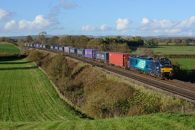 "88004 ""Pandora"" hauls the Mossend-Daventry Tesco train near Gretna on 14/10/18."