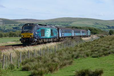 "68005 ""Defiant"" & 67017 ""Hornet"" top & tail the 15.31 Barrow-Carlisle at Foxfield on 9/8/18."