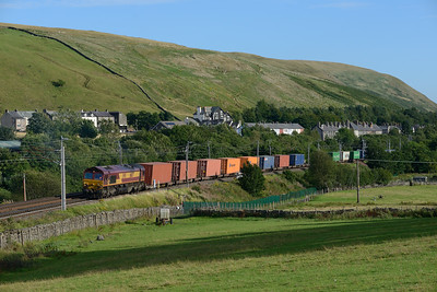 66077 leaves Tebay loop with the Seaforth-Mossend intermodal on 5/8/18.