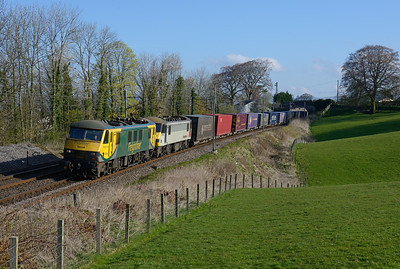 90042 + 90047 haul Coatbridge-Daventry containers near Oxenholme on 13/4/19.
