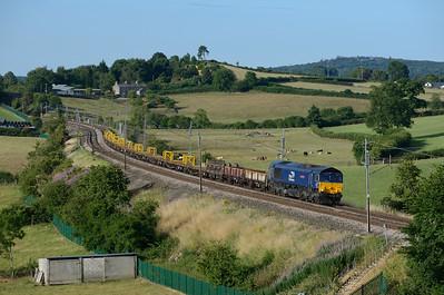 "66301 ""Kingmoor TMD"" passes Woodhouse with a late running Crewe-Carlisle engineers train on 9/7/18."