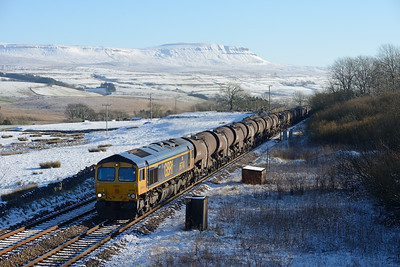 "66740 ""Sarah"" toils past Salk Lake with the Wembley-Irvine china clay tanks on 23/1/19."