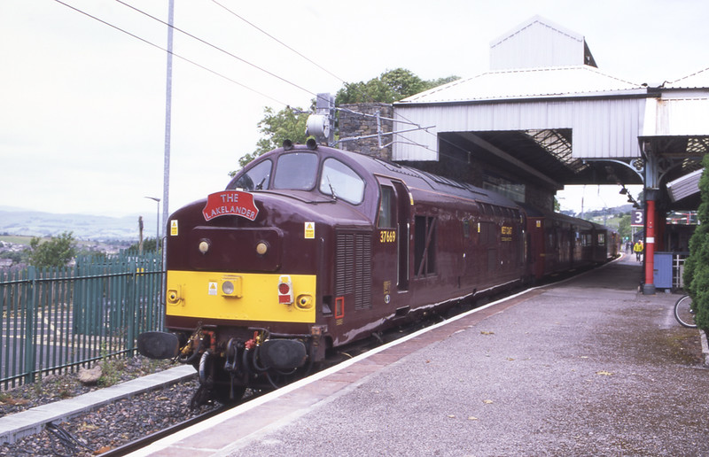 First trip in service completed; 37669 with 57316 on the rear stand in platform3 at Oxenholme having arrived with the 15:20 bus replacement rail service from Windermere, 17/6/2018.